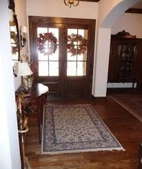 Here's my foyer rug before and after  a new area rug and the tired  Oriental it replaced.