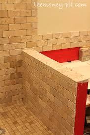 master bathroom week 6 tiling shower floor curb and knee wall the kim six fix