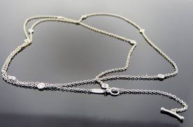 photograph of elsa peretti tiffany co platinum necklace and bracelet set diamond by yard