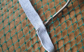 from those rug making kits you used to many years ago go through the backing and out again hook on a piece of fabric about in the middle of it