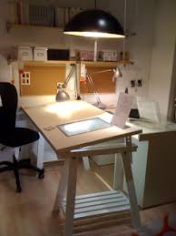 I love the look of this architect style desk. I've always wanted something  like this but will probably have to lower the tilt when I want to use my  sewing ...