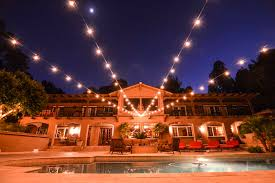 market lights string lights wedding lighting backyard wedding outdoors