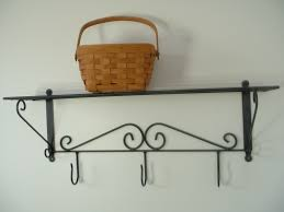 wrought iron bathroom shelf. Furniture. Black Wrought Iron Wall Shelf With Towel Hook And Brown Basket On White Bathroom