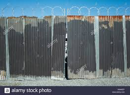 corrugated metal fence. Delighful Fence Worn Corrugated Metal Fence Razor Wire Above And Corrugated Metal Fence