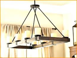 pillar candle rectangular chandelier hotel royal me comfortable linear harmonious 2