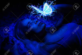 Dark Blue Light Concept Of A Woman Laying In Bed In The Dark Illuminated With