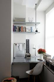 tiny home office. This Tiny Home Office Has Limited Room For Shelving, So Its Occupant Carried The Shelves Out Past Wall. A Metal Suspension Rod From Ceiling Supports I