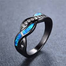 blue fire crossed black gold ring magick jewelry