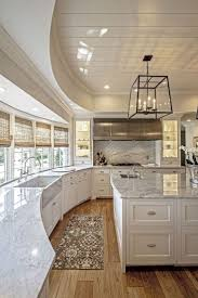 Boyse Residence - white kitchen with ceiling cutout, marble counters, wood  plank flooring, and large kitchen island