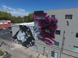 los angeles based graffiti artist drew merritt left his mark on the sacramento native american on wall art street names with sacramento mural festival returns as wide open walls