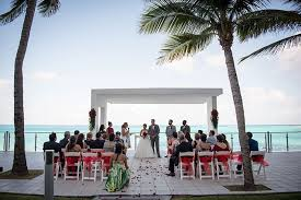 hotel riu cancun has a spot for your private wedding ceremony choose a bright color to contrast the light turquoise color of the ocean in the background