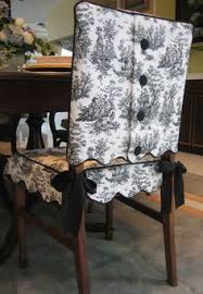 scalloped edge toile chair suit with covered on closure the skirt ties on with coordinated satin ribbon ties both the jacket and skirt are lined