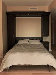 a murphy bed is a fold away wall bed that can be pulled down or folded back into a closet as and when needed if you live in a small apartment