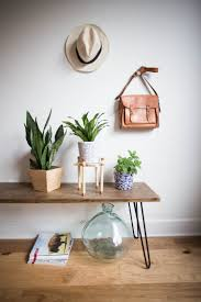 the copper and wood materials give it warmth and cosiness the 6 wooden square base is large enough to hold most small sized planter pots