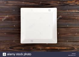 square table top view. Empty Square White Plate On Wooden Table Top View. View O