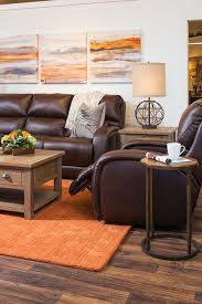 furniture the brick. Living Room With White Brick Walls, Brown Leather-look Furniture, Pops Of Bold Furniture The