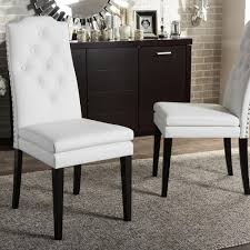 baxton studio dylin white faux leather upholstered dining chairs set of 2