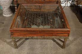 19th century carved indian window made into a coffee table for