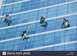 bosun chair window washing. stock photo - window cleaners cleaning windows of modern office tower high rise building skyscraper using rds ropes and bosun\u0027s chair bosun washing