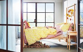 Incredible winter living room design ideas for holiday spirit Tray Bedroom With Large Windows Wooden Bedframe And Yellow And Pink Layered Bedding Ikea Ideas Ikea
