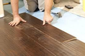 laminate installation man installing new laminate wood flooring abstract laminate flooring installation cost per square foot