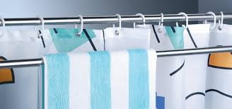 how to use extra shower curtain rods to increase bathroom storage more