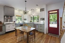 in an unmon twist the front door of the house opens into the expansive kitchen rauser landed on this concept after researching dozens of historic