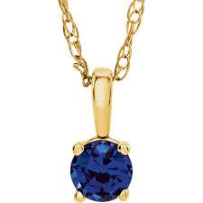 magnificent 14 karat yellow gold round genuine blue sapphire
