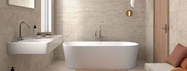 create a stunning effect in your bathroom with our new lunar range ceramic wall tiles with modern feature and porcelain floor tiles