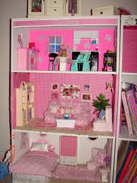 diy barbie house from a shelf a girl and a glue gun