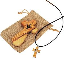 olive wood comfort cross from bethlehem with holy spirit dove cutout in sackcloth bag matching olive wood pendant