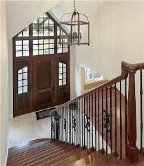 traditional cage iron foyer light over stairs with classic style model for decorate entry room interior lighting photo