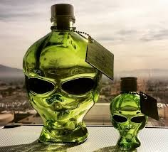 outer space vodka a multi distilled spirit that comes in a bright green glass alien head bottle