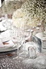 winter wedding centerpiece silver sequin glitter table cloth  http://www.mirrormirrorincbridal.
