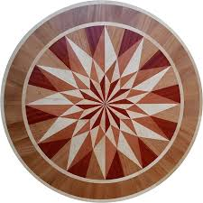 hardwoods used in the geometric floor medallion are curly white maple flaming red padauk tiete rosewood and african gany