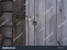old wooden door with a lock background wallpaper