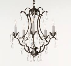 vintage look modern black wrought iron chandeliers with hanging crystal and candle holder for dining room lighting ideas