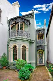 small victorian house plans ornate decorations stone pavers terrace tall windows green walls door flat roof