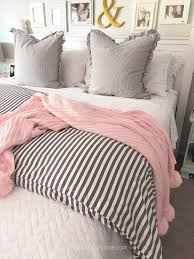 love this soft gray white and fl bedding learn how to layer a coverlet with
