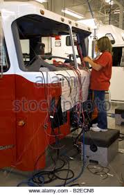 chassis stock photos chassis stock images alamy female worker installing wiring into a newly manufactured fire truck chassis at spartan motors in charlotte
