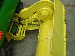 1973 112 electric lift jd tiller attachment question holes that you will see and the tiller lift rod black part below if you can get it all off an existing tractor it will save you a lot of searching