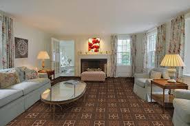 modern living room carpet gold stainless steel chandelier varnished teak wood legs pink white oval pattern