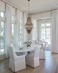oval marble white linen skirted dining chairs with marble table