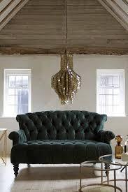 forest green velvet 2 seater sofa