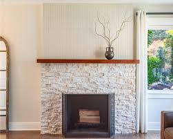 lofty fireplace stacked stone white interior scheme wooden mantel idea veneer photo cost tile picture surround