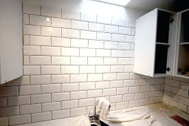 how to grout wall tile in kitchen white grout white brick tile wall white kitchen wall