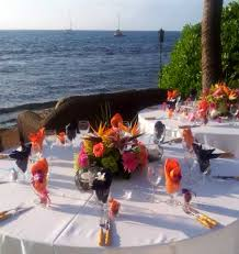 orange napkins with white table cloth and bamboo utensils for a catered event on maui in wedding catering contract sample