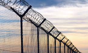 barbed wire fence prison.  Prison Barbed Wire Outside A Prison In Wire Fence Prison