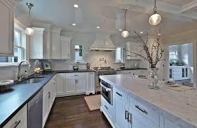 traditional white kitchen with london gray quartz island and black quartz main countertops