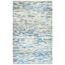 blue striped area rug and cream